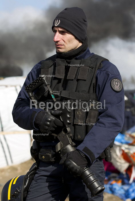 CRS riot police with tear gas grenade launcher. Demolition of the Jungle refugee camp, Calais, France - Jess Hurd - 2016-03-03