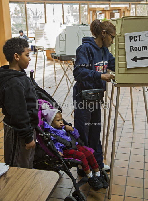 Detroit, Michigan Children watching mother voting in the primary presidential election - Jim West - 2016-03-08