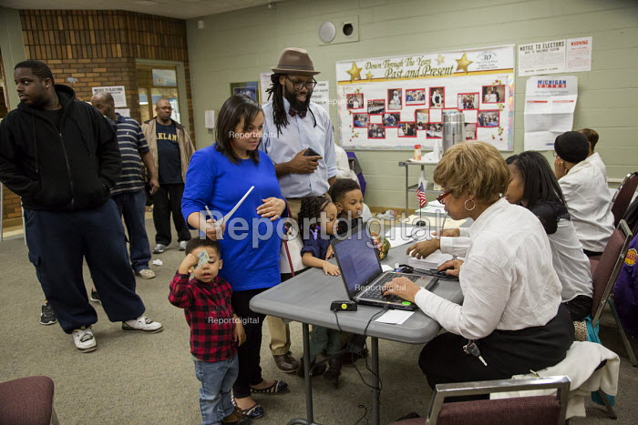 Detroit, Michigan - A family with children checking in with election officials before voting in the primary presidential election - Jim West - 2016-03-08