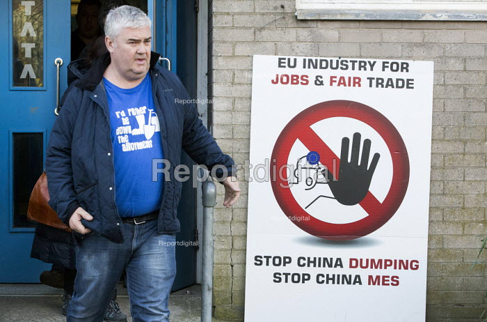 Worried Tata Steel workers passing Stop China Dumping cheap steel sign, EU industry for Jobs and fair trade, Port Talbot, Wales - Paul Box - 2016-03-30