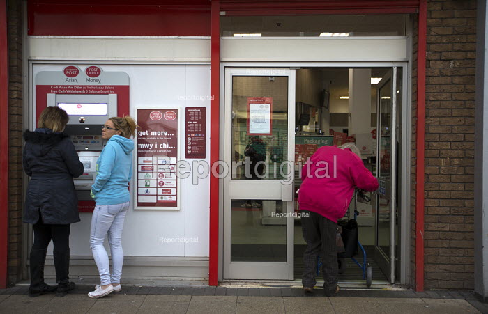 Elderly woman entering the post office, shopping precinct, Port Talbot, South Wales - John Harris - 2016-04-04