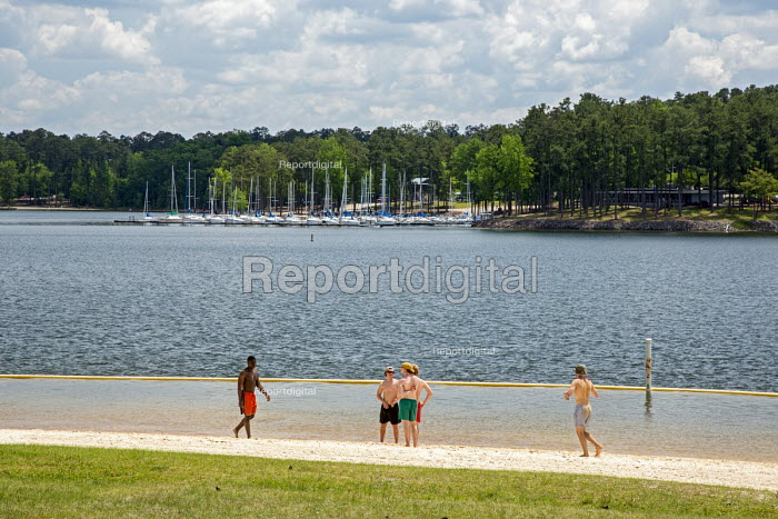 Pollards Corner, Georgia - Young men on the beach of J. Strom Thurmond Lake. The lake is created by the Thurmond Dam for hydropower, flood control and recreation. It is named after the late segregationist Senator from South Carolina. - Jim West - 2016-04-25