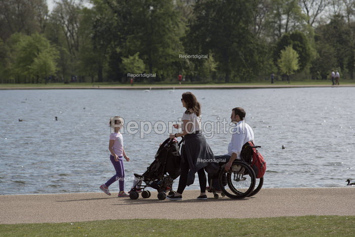 Family with a pushchair and wheelchair, Kensington Gardens, London - Philip Wolmuth - 2016-05-08