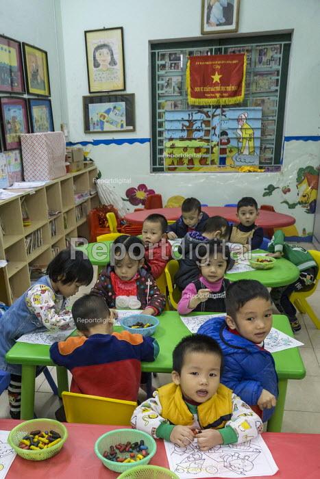 Report digital photojournalism - Hanoi Vietnam Workplace creche for