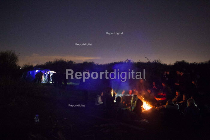 Illegal rave or free party, Huddersfield, West Yorkshire, round the campfire - Connor Matheson - 2016-04-22