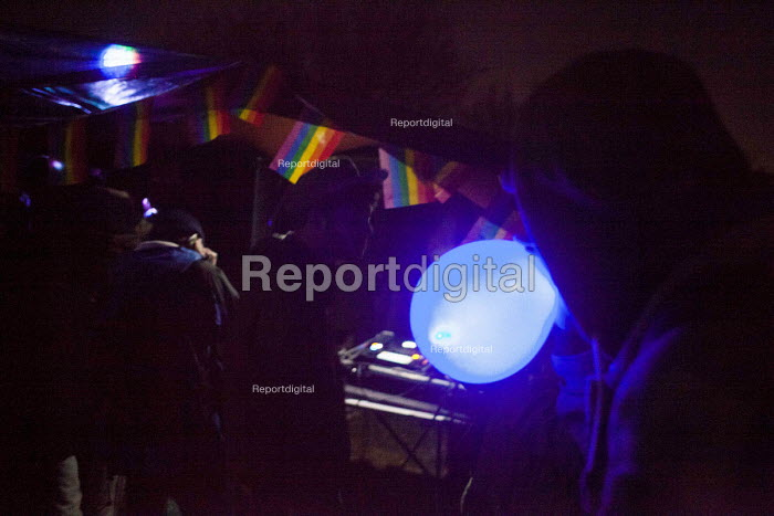 Illegal rave or free party, taking Nitrous oxide using a balloon, Huddersfield, West Yorkshire - Connor Matheson - 2016-04-23
