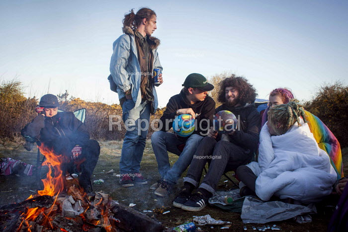 Illegal rave or free party, taking Nitrous oxide using balloons, round the campfire, Huddersfield, West Yorkshire - Connor Matheson - 2016-04-23