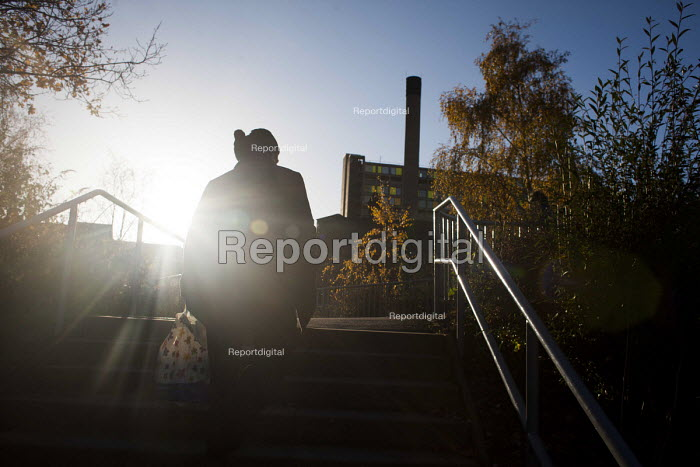 Man walking to work near the privatised Park Hill estate, Sheffield, Yorkshire - Connor Matheson - 2015-12-02