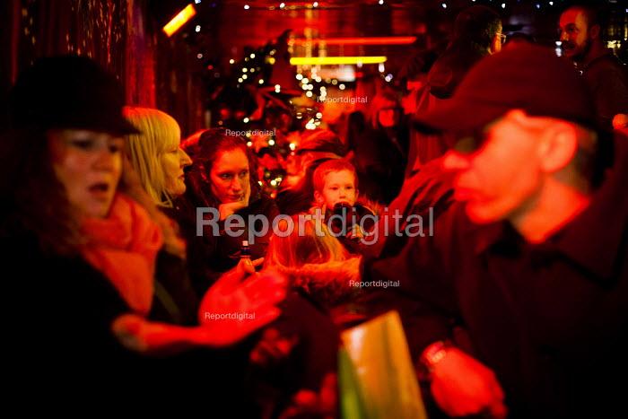 Families enjoying a drink inside a city centre pop up pub, Sheffield, Yorkshire - Connor Matheson - 2015-12-08
