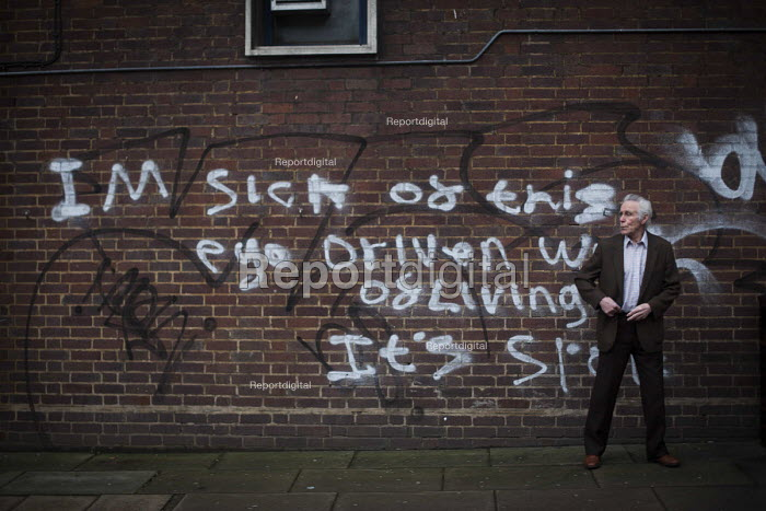 Graffiti on the wall by a bus stop as a passenger waits for a bus, Sheffield, Yorkshire, I'm sick of this ego driven way of living.. - Connor Matheson - 2016-01-09