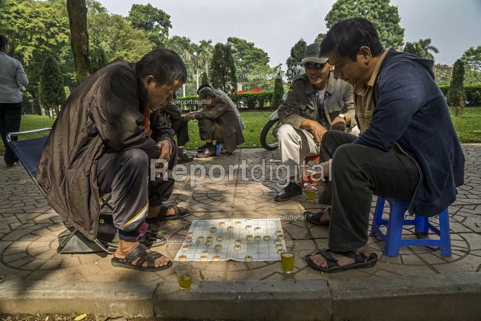 Hanoi, Vietnam, Men play board game dangua or kick horse on the pavement, Lenin Park - David Bacon - 2015-12-09