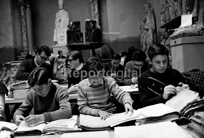 Florence Floods, Italy, 1966 in which 100 died and many cultural artefacts, books, paintings and sculptures were damaged. It was the worst flood for five hundred years. Schoolchildren helping to clean up the files of the Museo del Duomo. Like many in the City who assisted in repairing damage from the flood, they were commonly known as 'Mud Angels'. - Romano Cagnoni - 1966-11-11