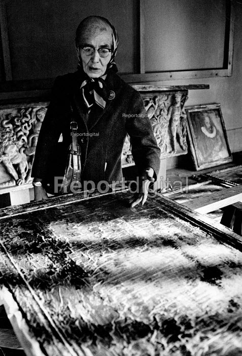 Florence Floods, Italy, 1966 in which 100 died and many cultural artefacts, books, paintings and sculptures were damaged. It was the worst flood for five hundred years. Dr Luisa Bucherucci, Director of the Uffizi Gallery, with damaged paintings covered with tissue paper to avoid further loss of colour. - Romano Cagnoni - 1966-11-11