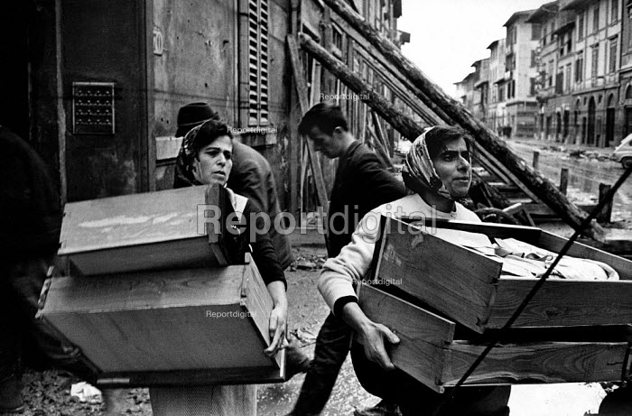Florence Floods, Italy, 1966 in which 100 died and many cultural artefacts, books, paintings and sculptures were damaged. It was the worst flood for five hundred years. In the poor quarter of Piazza Gavanina, a tenement block seven storeys high and about 150 yards long has become uninhabitable despite the danger of its collapse, residents are still allowed in to salvage whatever they can of their personal belongings. - Romano Cagnoni - 1966-11-14