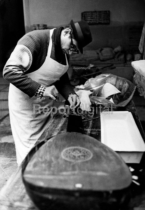 Florence Floods, Italy, 1966 in which 100 died and many cultural artefacts, books, paintings and sculptures were damaged. It was the worst flood for five hundred years. In the Bardini Museum, Bernard Robin, a freelance restorer from New York repairing damage to old musical instruments. On hearing the news of the flood disaster, he flew to Florence at his own expense to assist in the relief effort, bringing with him the chemicals vital to his repair work. - Romano Cagnoni - 1966-11-11