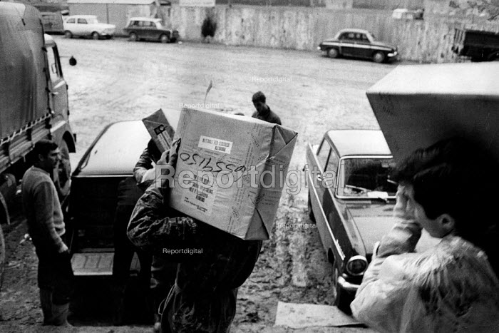 Florence Floods, Italy, 1966 in which 100 died and many cultural artefacts, books, paintings and sculptures were damaged. It was the worst flood for five hundred years. Parcels arriving from Scotland as part of the international aid programme with urgently need materials to aid in the flood relief effort. - Romano Cagnoni - 1966-11-11