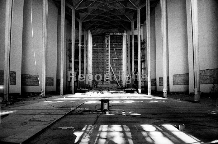 The rebuilding of Coventry Cathedral, completed in 1962, more than two decades after suffering terrible damage as a result of bombing during the Second World War. Laying the floor in the Cathedral. - Alex Low - 1962-03-03