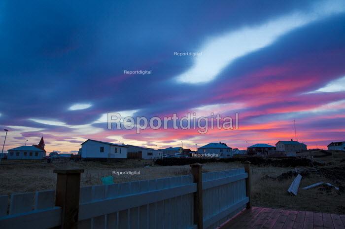 Winter sunset over a small fishing village. Grindavik, South West Iceland - Jess Hurd - 2016-04-28