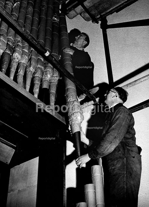 Rebuilding of Coventry Cathedral being completed 1962 more than two decades after the bomb damage World War Two. Installation of the organ pipes at the Cathedral; it took seven men 12 months to complete the installation - Alex Low - 1962-03-03