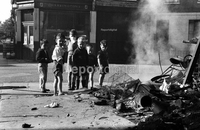 Children playing in th aftermath, Notting Hill race riots, London 1958 - Alan Vines - 1958-09-24
