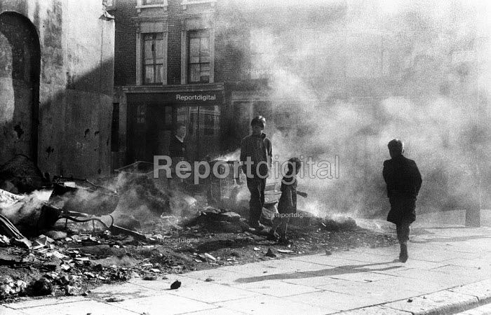 Children playing in the street in the aftermath of the Notting Hill race riots, London 1958 - Alan Vines - 1958-09-24