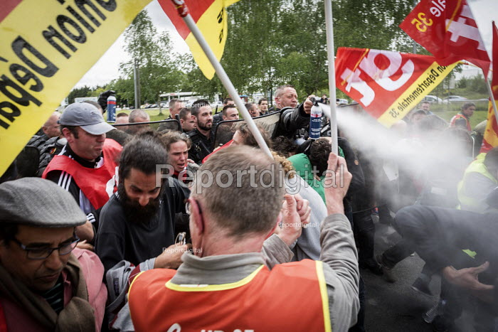 Police spraying tear gas as GCT block access to a fuel depot on the outskirts of Rennes, Unions strike against proposed labor reforms, France - Jean Claude Moschetti - 2016-05-20