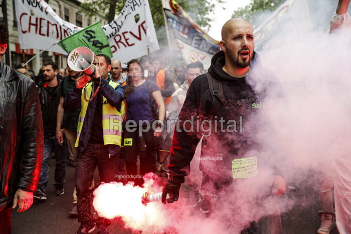 Paris France Protestor with smoke and flare, Union protest against proposed labor reforms, France Banner Lets be ungovernable - Nicolas Tavernier - 2016-05-26