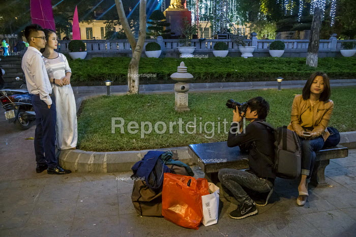 Hanoi, Vietnam A bride and groom having their picture taken at night by Hoan Kiem Lake, a custom for women about to get married - David Bacon - 2016-01-05
