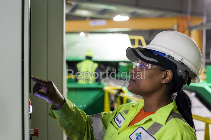 Southfield, Michigan A worker operates a control panel for machinery, ReCommunity materials recovery facility, where recyclable materials are sorted and baled. - Jim West - 2016-03-31