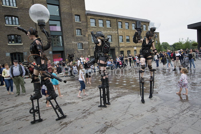 Punkx festival celebrating 40 years of punk, performance from the Mutoid Waste Company, Kings Cross, London. Stilt walkers - Jess Hurd - 2016-06-04