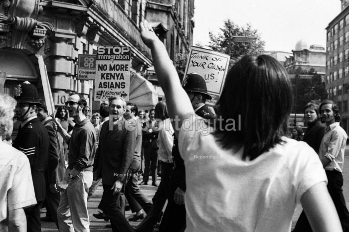National Front demonstration to Conway Hall, Red Lion Square 1974 and counter demonstration led by Liberation, London An anti-Fascist protestor mocks the NF marchers with a Nazi style salute. In the riot in the Square that followed clashes between police and demonstrators, Warwick student, Kevin Gately was killed the first fatality of rioting in the UK in fifty years - Mike Tomlinson - 1974-06-15