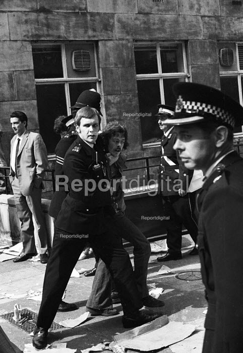 National Front demonstration to Conway Hall in Red Lion Square and counter demonstration led by Liberation, London, 1974. An anti-fascist protestor is placed in a strangle hold and arrested by police. In the riot in the Square that followed clashes between police and demonstrators, Warwick student, Kevin Gately was killed the first fatality of rioting on British soil in fifty years. - Mike Tomlinson - 1974-06-15