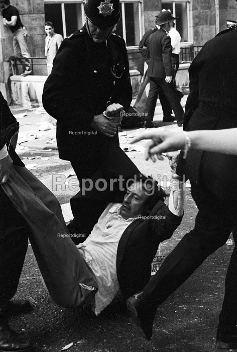 National Front demonstration to Conway Hall, Red Lion Square 1974 and counter demonstration led by Liberation, London. An anti-fascist protestor is arrested by police and dragged away. In the riot in the Square between that followed clashes between police and demonstrators, Warwick student, Kevin Gately was killed; the first fatality of rioting on British soil in fifty years. - Mike Tomlinson - 1974-06-15