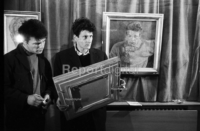 Artist Lucian Freud with one of his favourite life models, Charlie Lumley at an exhibition of Freud's work, London, 1958. To their right is a painting titled Charles Lumley - Alan Vines - 1958-11-27