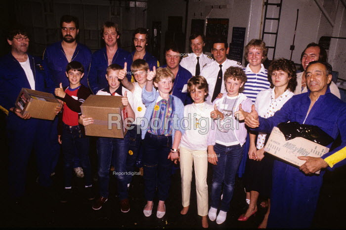 Miners strike children aboard a cross Channel ferry 1984 with gifts from the trade union members of the crew en route to a holiday to northern France paid for by French trade unions in solidarity with miners on strike - Stefano Cagnoni - 1984-07-30