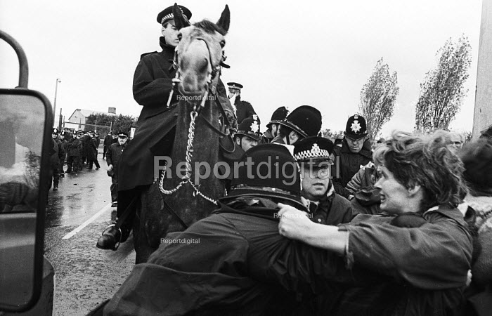 Blockade of the USAF Air Base at Greenham Common on the third anniversary of the establishment of the Greenham Common Womens Peace Camp. Police force back women as they try to prevent military vehicles from entering the Base. - Stefano Cagnoni - 1984-09-23