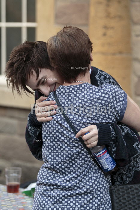 Teenager embracing a friend, Alcester Warwickshire - John Harris - 2016-06-12