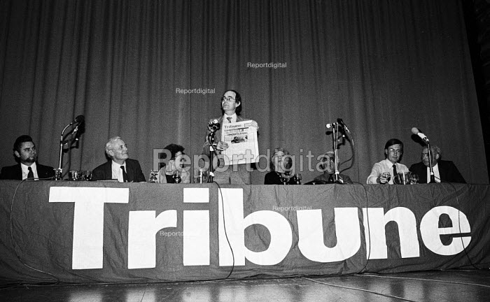 Chris Mullin, Editor of Tribune, holding up a copy of the newspaper, Tribune Rally, Labour Party Conference, Brighton, 1983 - Stefano Cagnoni - 1983-10-05