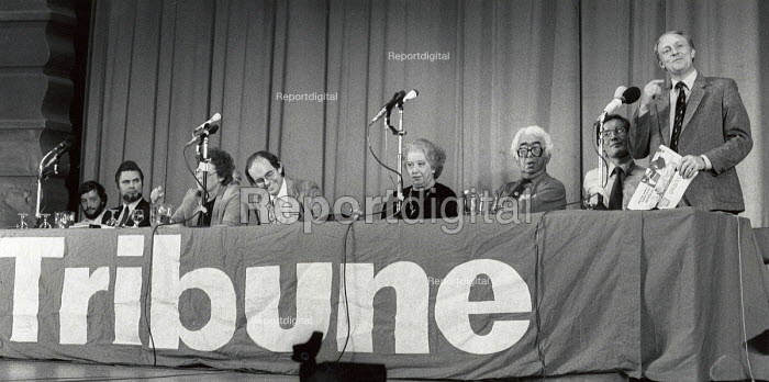 Chris Mullin, Editor of Tribune smiling, Neil Kinnock MP speaking, Tribune Rally, Labour Party Conference, Brighton, 1983 - Stefano Cagnoni - 1983-10-05