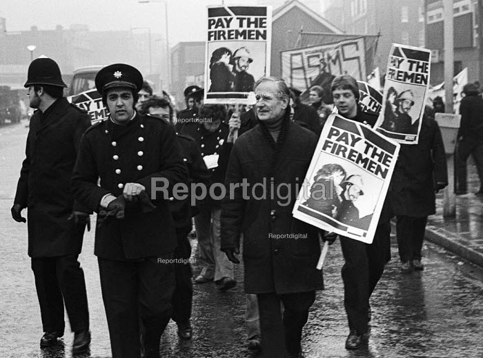 Firefighters National Strike, 1977. Firemen on strike for more pay march from Old Street Fire Station to Bethnal Green, east London, in support of their ten percent pay claim - John Sturrock - 1977-12-07
