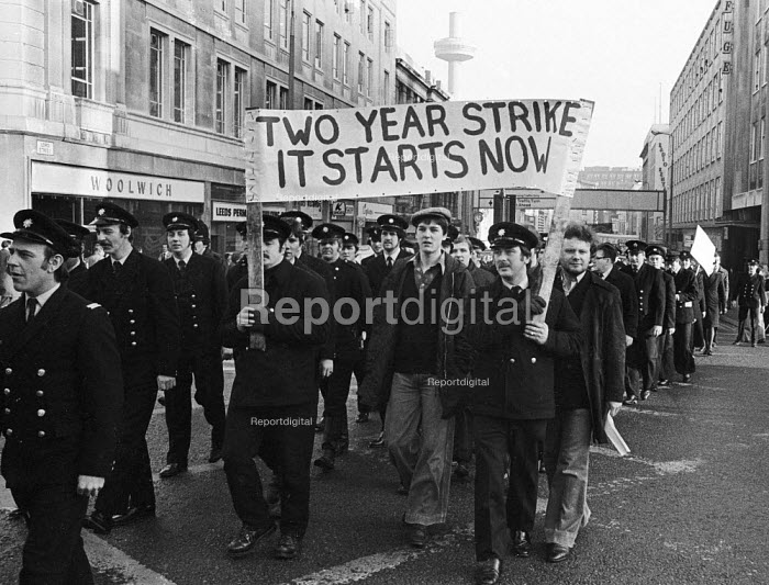 Firefighters National Strike, 1977. Firemen on strike for more pay march through Liverpool in support of their pay claim - John Sturrock - 1977-12-10