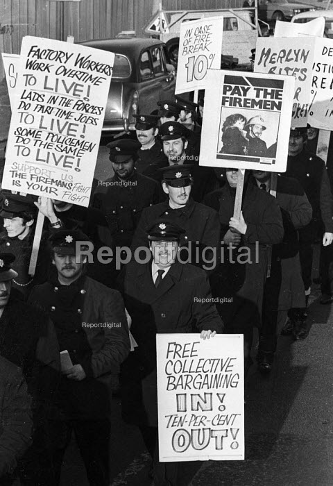 Firefighters National Strike, 1977. Firemen on strike for more pay march through Liverpool in support of their ten percent pay claim - John Sturrock - 1977-12-10