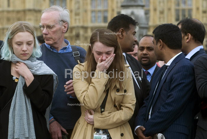 Vigil in Parliament Square for Jo Cox MP. Ruth Price Parliamentary Assistant for Jo Cox MP at the House of Commons is distraught as she looks at the floral tributes. Vigil in Westminster for murdered Labour MP, Jo Cox, London - Stefano Cagnoni - 2016-06-17