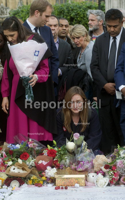 Vigil in Parliament Square for Jo Cox MP. Woman in visible distress as she looks at the floral tributes. Vigil in Westminster for murdered Labour MP, Jo Cox, London - Stefano Cagnoni - 2016-06-17