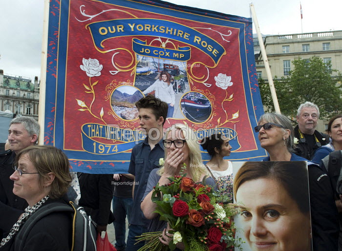 Memorial event to celebrate the life of murdered Labour MP,Jo Cox. Love Like Jo, Trafalgar Square, London. Woman in tears as she listens to a speech from Jo's husband, Brendan Cox, Our Yorkshire Rose banner. - Stefano Cagnoni - 2016-06-22