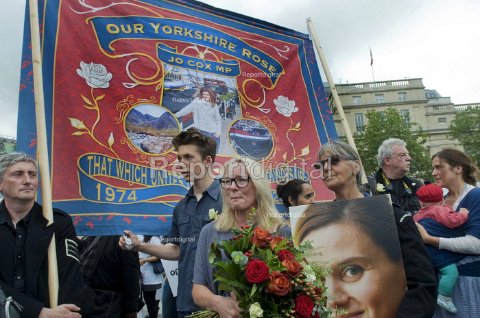 Memorial event to celebrate the life of murdered Labour MP, Jo Cox. Love Like Jo, Trafalgar Square, London. Woman in tears as she listens to a speech from Jos husband, Brendan Cox, Our Yorkshire Rose banner. - Stefano Cagnoni - 2016-06-22