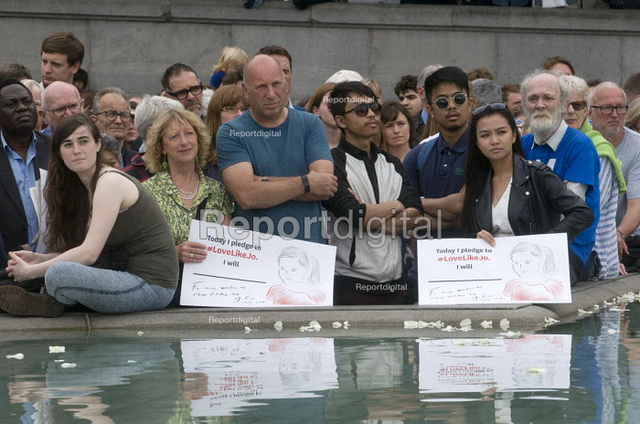 Memorial event to celebrate the life of murdered Labour MP, Jo Cox. Love Like Jo, Trafalgar Square, London. Reflections of her message in the waters of the fountain at Trafalgar Square are carried by women in the mixed crowd. - Stefano Cagnoni - 2016-06-22
