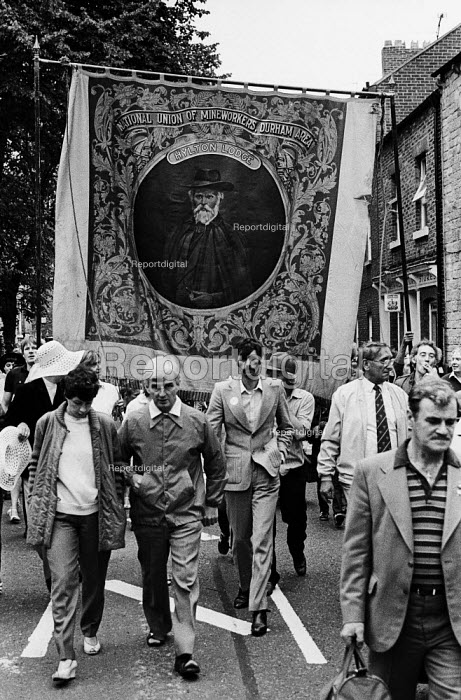 "Durham Miners Gala, 1983. Miners and their families march on the 100th Anniversary of the Durham Miners Gala or ""Big Meeting"". The Hylton Lodge pit banner bearing the portrait of Socialist, Keir Hardie is carried through the streets of Durham - Stefano Cagnoni - 1983-07-16"