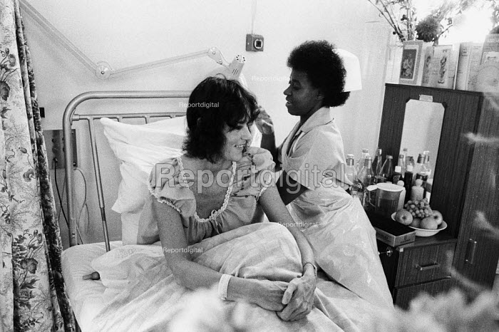 NHS workers occupying South London Hospital for Women against threatened plans for closure, London, 1984 Nurse attending to a supportive patient. - Stefano Cagnoni - 1984-07-05
