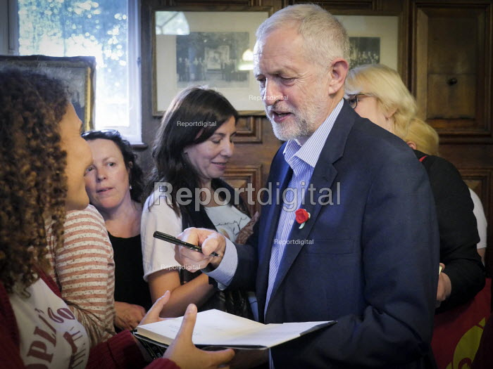 Durham Miners Gala 2016, Jeremy Corbyn at an eve of gala public meeting at Redhills, the HQ of Durham area NUM Durham City, Co Durham. Jeremy Corbyn signing an autograph for supporters after his speech - Mark Pinder - 2016-07-08